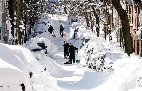 Boston residents dig out their cars after the blizzard. Photo courtesy of Winslow Townsend / Associated Press